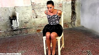 Gagged beauty Eveline Dellai spreads her legs for a forced orgasm